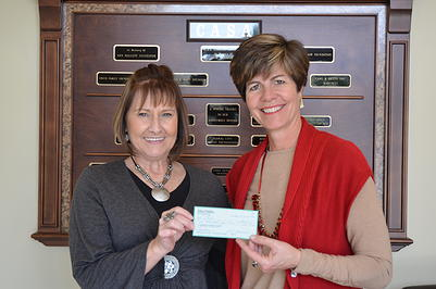 Presenting a check from reading income to CASA, a women's shelter in Inverness, FL.